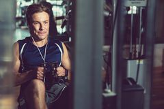 Using Rowing Machine at Gym royalty free stock photography