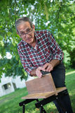 Using a sanding block on the edge of a board Royalty Free Stock Photography