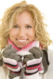 Using a scarf. Smiling blond woman with a scarf and gloves stock photos