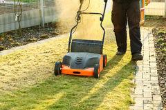 Using a scarifier Royalty Free Stock Photography
