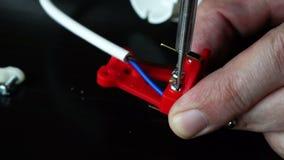 Using screwdriver for repair electrical plug. Close up of using screwdriver for repair electrical plug stock video