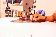 Using a sewing machine stock image