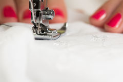 Using a sewing machine Stock Photo