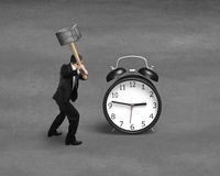 Using sledge hammer to hit alarm clock Stock Image