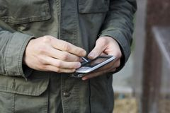 Using smart phone. Electronic correspondence with the help of a small pocket computer Stock Photography