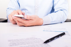 Using smart phone for business communication.  Royalty Free Stock Photos