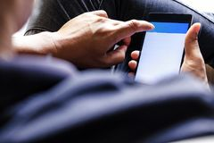 Using Smart Phone. Closeup of man hands holding and touching a smartphone Stock Photography