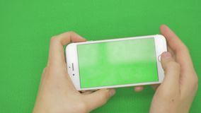 Using smart phone on green screen with various hand gestures, horizontally , close up - green screen. Using smart phone on green screen with various hand stock video