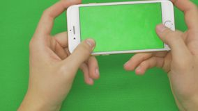 Using smart phone on green screen with various hand gestures, horizontally , close up - green screen. Using smart phone on green screen with various hand stock footage