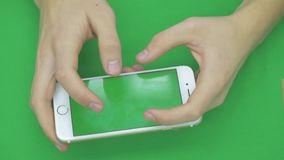 Using smart phone on green screen with various hand gestures, horizontally , close up - green screen. Using smart phone on green screen with various hand stock video footage