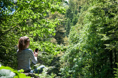 Using a smart phone in nature Stock Photo