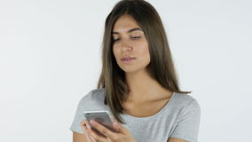 Using Smartphone Beautiful Girl, White Background in Studio. Young Designer , Creative Designer stock video