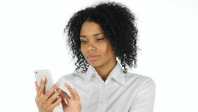 Using Smartphone for Browsing Online, Busy Afro American Woman Royalty Free Stock Images