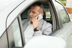 Using smartphone in a car Royalty Free Stock Photo