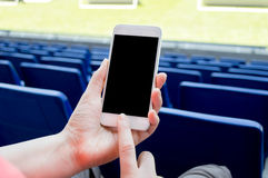 Using smartphone in the football stadium Stock Photography