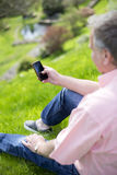 Using Smartphone in the Garden stock image