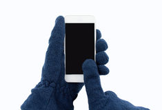 Using the smartphone with gloves Stock Images