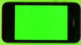 Using Smartphone With Green Screen. With various hand gestures,close up / on Green Screen Background stock video