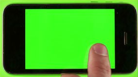 Using Smartphone With Green Screen. With various hand gestures,close up / on Green Screen Background stock video footage