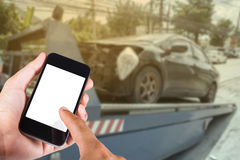 Using smartphone on hand with blurry background car on accident stock photos