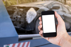 Using smartphone on hand with blurry background car on accident royalty free stock photo