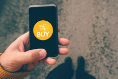 Using smartphone mobile app to shop online Royalty Free Stock Photography
