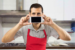 Using smartphone at my kitchen Royalty Free Stock Photography