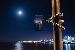 Free Using Smartphone On Flexible Tripod To Making The Photo Of Sea Night Landscape Royalty Free Stock Image - 155399316