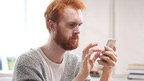 Using Smartphone for Online Browsing, Man with Red Hairs Stock Images