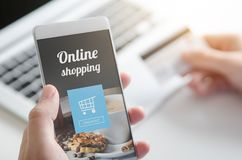 Using smartphone for online shopping. Credit card internet pay. Using smartphone for online shopping. Credit card internet payment. Web application, laptop Royalty Free Stock Photography