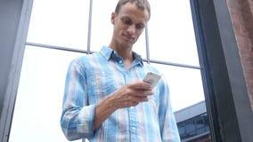 Using Smartphone, Outdoor. Creative designer , businessman stock video footage