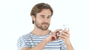Using Smartphone, Texting Message. Designer , young man , handsome stock footage