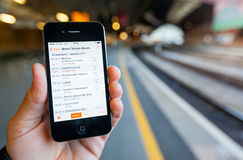 Using a Smartphone to Check Train Times and Platforms Stock Image