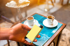 Using smartphone in the turkish cafe Royalty Free Stock Image