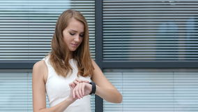 Using Smartwatch by Beautiful Girl, Outside Office stock video footage