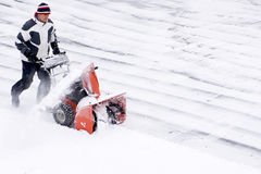 Using a Snowblower after a Winter Storm Royalty Free Stock Photos