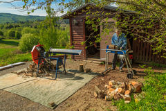 Using the splitter to split a log into firewood Royalty Free Stock Image