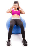 Using a stability ball for crunches Royalty Free Stock Photos