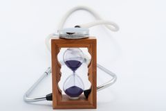 Stethoscope and hourglass Stock Images
