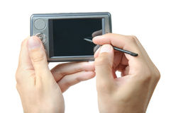 Using stylus on PDA. Smartphone, GPS device. Isolated on white background Stock Photos