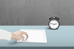Using table in office. Using table with alarm clock in office Stock Photo