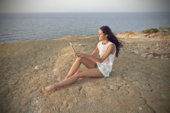 Using a tablet at the beach Stock Image
