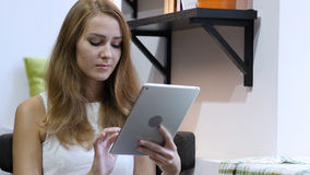 Using Tablet for Browsing Online, Young Girl Stock Image