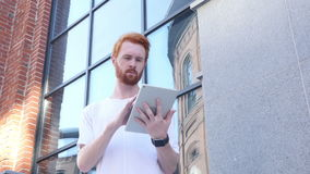 Using Tablet for Browsing, Outdoor. Creative designer , businessman stock footage