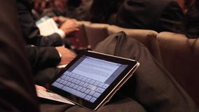 Using a tablet at a business meeting (1 of 2). A view or scene of Technology stock video footage
