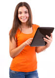 Using Tablet Computer or iPad. Beautiful happy young woman smiling and using a tablet computer isolated on white Stock Images