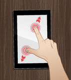 Using Tablet On Desktop. Static `movement` of a hand, interacting with a GUI of a tablet PC Stock Photography