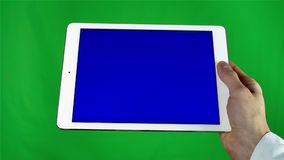 Using Tablet Pc With Blue Screen. Man Using Tablet Pc With Blue Screen on a Green Screen Background  with Various Hand Gestures (touch, scroll and more stock video footage