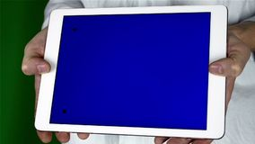 Using Tablet Pc With Blue Screen. Man Using Tablet Pc With Blue Screen on a Green Screen Background  with Various Hand Gestures (touch, scroll and more stock footage