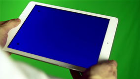 Using Tablet Pc With Blue Screen. Man Using Tablet Pc With Blue Screen on a Green Screen Background  with Various Hand Gestures (touch, scroll and more stock video